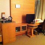 Desk tv minibar area