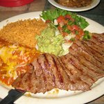 Carne asada, chicken enchilada, and side items
