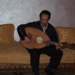 Abdullah playing the oud