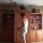 grandma checking out the media cabinet (has a blu-ray/DVD player, CD player, flat screen TV and