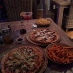 Chinese duck pizza, chicken & chorizo pizza (with added BBQ sauce), skinny fries & sweet potato