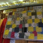 A quilt behind our booth