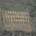 Close-up of granaries on hills across from ruins