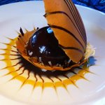 Share a dessert: Black Pearl-Chocolate glazed ganache in a clamshell cookie.
