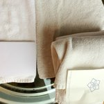 FILTHY TOWELS SERVED TO OUR BATHROOM. ON LEFT LOWER HAND, WHITE TOWEL, I HAD IT WITH ME FROM US