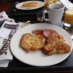 Delish breakfast! French toast, bacon, croissant, coffee and juice