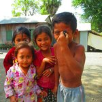 Village kids having fun getting pictures