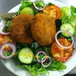 home made tuna fish cakes with side salad.