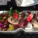 Our signature Charcuterie Dish a fine selection of imported meats and cheeses