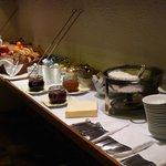 The buffet with all the spreads, cutlery and crockery for breakfast