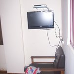 TV position not in front of the bed but facing the wall.