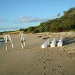 Preps for beach wedding; notice; no gawking tourists in site!