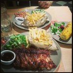 half rack of ribs meal, side of corn, butterfly chicken meal
