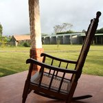 Two relaxing rocking chairs on the porch where you're surrounded by all the ranch animals.