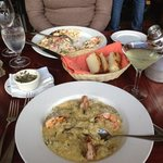 Prawns on a bed of mushroom risotto (near) and lobster pizza(far).  Cucumber martini.