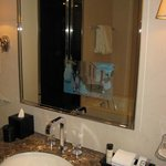 TV in the mirror in the Deluxe King bathroom