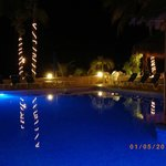 Looking across the pool at night