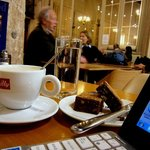 Mobile-officing with a latte and brownie at Michaelhouse Cafe in Cambridge