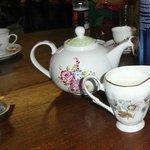 Tea, served in a cute vintage style tea pot.