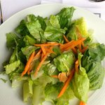 Romaine Lettuce with toasted almonds and honey vinaigrette.