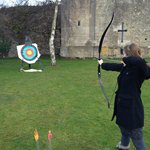 Doing archery at a castle! Priceless.