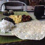 Chorizo sausage with eggs, black beans, rice and fresh flour tortillas. Wonderful!