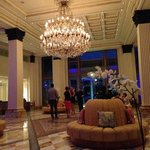 Grand piano tunes filled the magnificent foyer adorned with glimmering chandelier