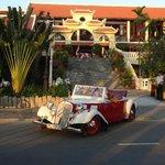 antique car leaving hotel