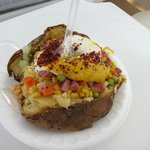 Some type of snack always available. Baked potato by the poolside..