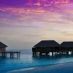 beautiful sunset over the superior water villas