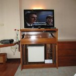 TV and minibar with desk