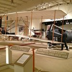 Juxtaposition of a space capsule & Wright Flyer