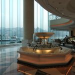 a uge lobby with a panoramic view of hong kong harbour