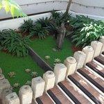 bella combinacion de jardin cercana al lobby