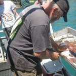 Captain Terry cleaning the snapper.