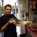 moi et un loup de 5kg pêche a Villeneuve louvet par notre pêcheur local