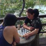 Playing Chess on the balcony (two against one - look on his shoulder)