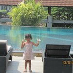 my daughter infront of the swimming pool