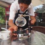 Barista Francini preparing coffee in a siphon in the Terraza