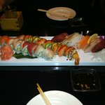 Variety of Sushi Rolls and Sashimi