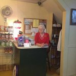 Miss Peggy greets customers with a big smile.