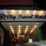 CITY TRAVEL HOTEL sign