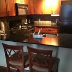 kitchen with 2 barstools