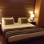 Bedroom with wooden floor.