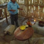 Julio explaining a traditional Mayan kitchen