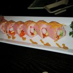 """""""Pink Lady"""" sushi roll -- two pieces already eaten -- I was HUNGRY!"""