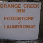 The sign welcoming you to the inn/foodstore/laundromat