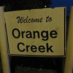 The sign welcoming you to Orange Creek