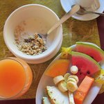 Breakfast, juice, granola, and fruit, yum!