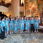 School choir in lobby singing carols
